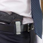 Holstered handgun in the belt of an officer