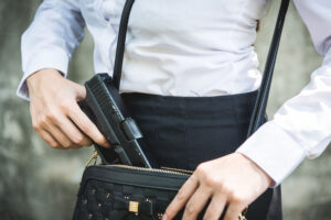Young woman with concealed handgun