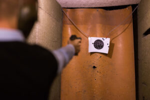 Man practicing firearms target shooting