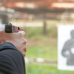 man learning how to shoot a pistol at a firearms training center